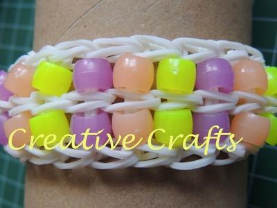 Como hacer una pulsera de gomitas con dos filas de abalorios. Rainbow Loom Bracelet beads.