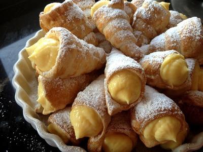 Conos de hojaldre rellenos de crema pastelera (sin lactosa). Custard filled horns (lactose-free)