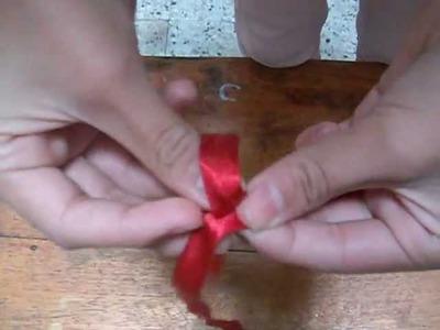 Como hacer una rosa con una cinta de tela