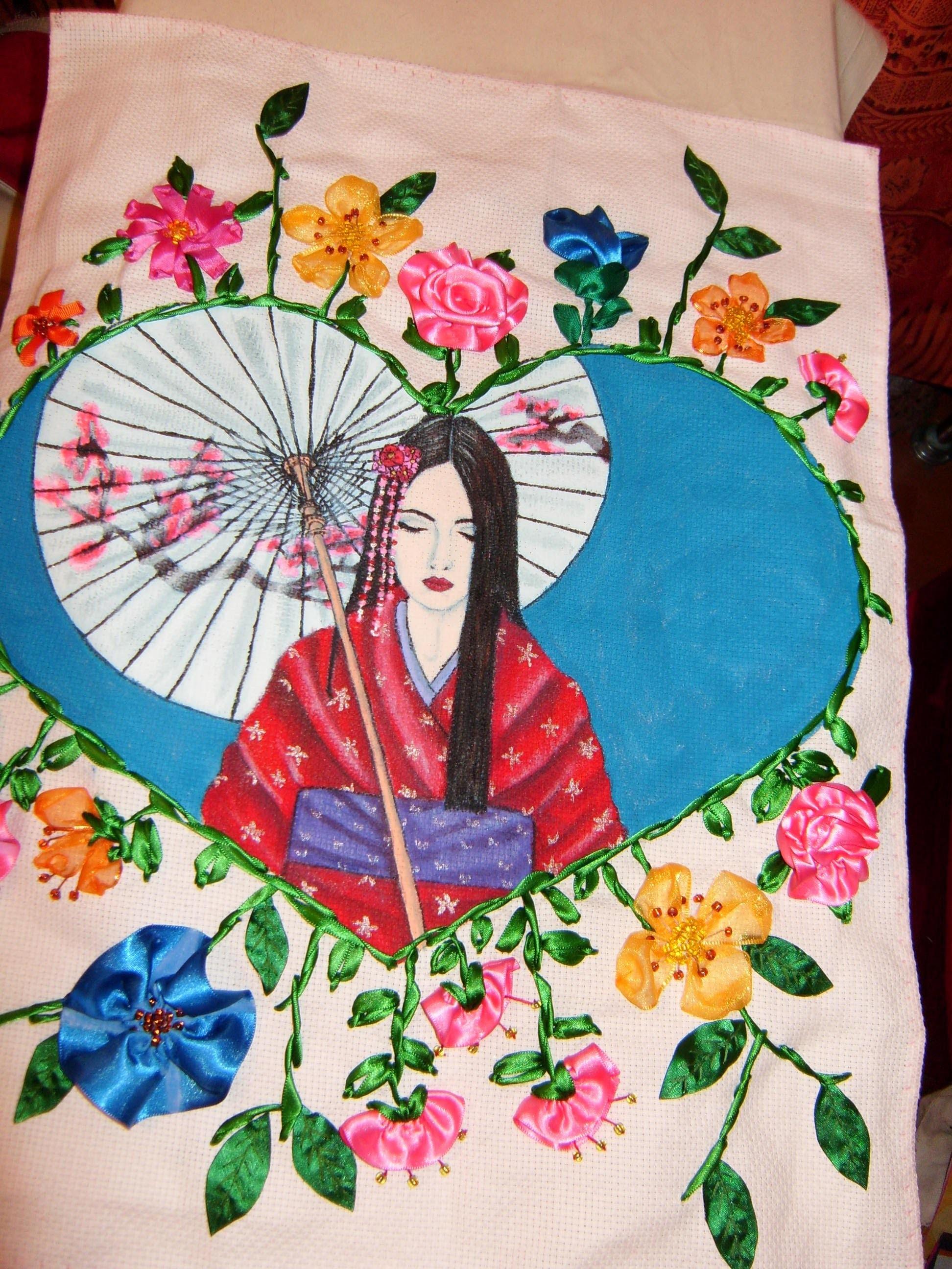 Excelente regalo hecho  con pintura en tela y flores bordadas en listón, para este día de la madre.