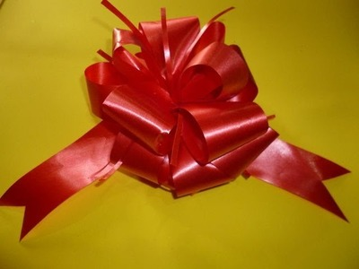 DIY FACIL MOÑO MAGICO NAVIDEÑO   EASY XMAS MAGIC RIBBON BOW