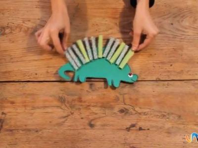 Hacer dinosaurio de papel con pinzas
