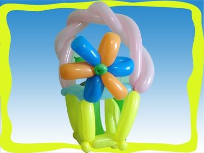 Canasta de globos con flores