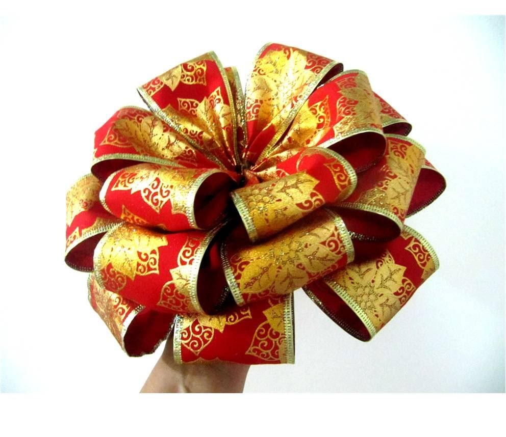 Moños flores navideñas de  tres capas en cintas