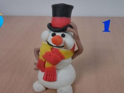 Hacer el cuerpo de plastilina de un muñeco de nieve (1.3)