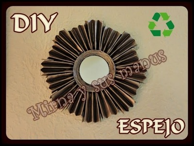 Decorando un espejo con botellas de plastico.Decorating a mirror with plastic bottles