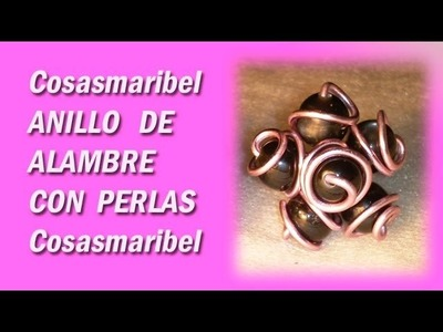 Anilloflor-sortija con espirales y perlas