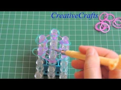 Tutorial como hacer una flor de gomitas. DIY Flower Rainbow Loom.