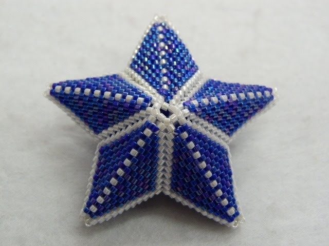 Colgante estrella tridimensional