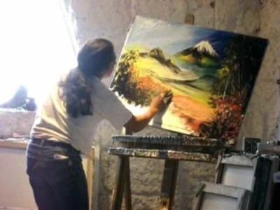Cristobal Ortega pinta un cuadro en pocos minutos