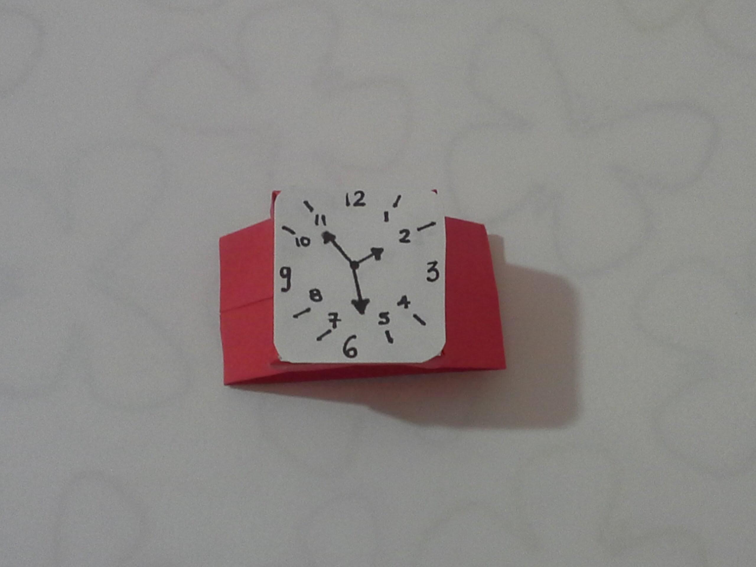 Como hacer un reloj de papel