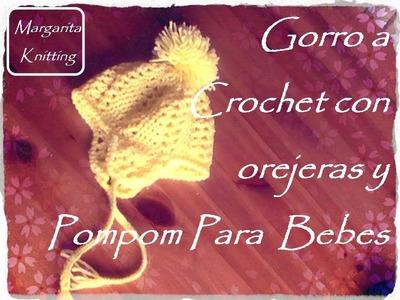 Gorro para bebe a crochet con orejeras y pompom (diestro)