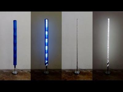 Còmo realizar una lámpara con botellas de plástico recicladas y un pie de lámpara con un palo de esc