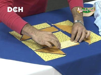 Almohadón con triángulos, cuadrados y rectángulos