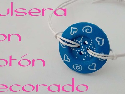 Pulsera con boton decorado. Bracelet with decorated button.