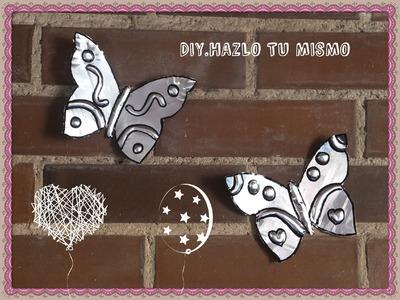 Mariposas reciclando bandejas de aluminio