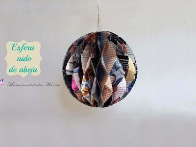 Esfera de nido de abeja con papel de revista