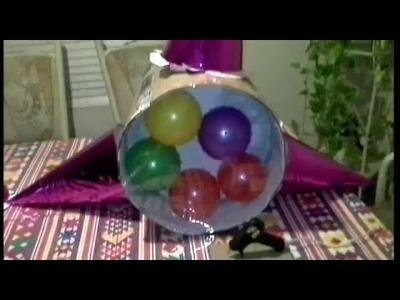 Como hacer una piñata de estrella con pelotas adentro.