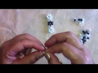 Pulsera de cristal blanco con morado