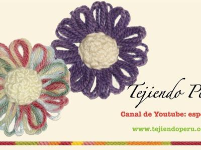 Flor con centro de nuditos en telar reloj o redondo