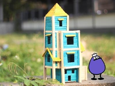 Hacer una casa para pájaros con palitos de paletas