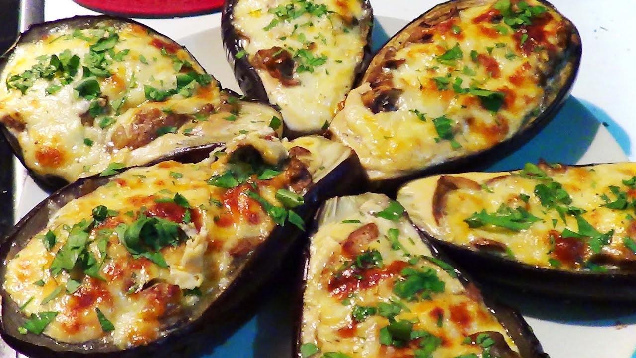 Berenjenas rellenas con champignones y gratinadas al horno.