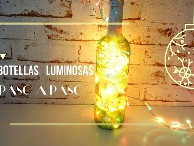 Cómo hacer una botella luminosa con decoupage para Navidad
