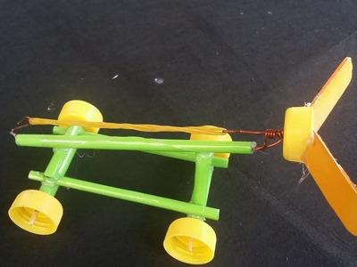 Como hacer un auto propulsado con goma | coche de papel