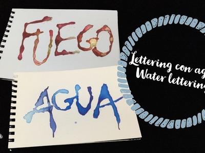 Lettering escrito con agua y gotas de acuarela. water lettering