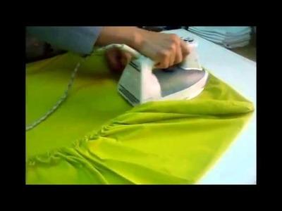 Cómo doblar y planchar una sábana ajustable