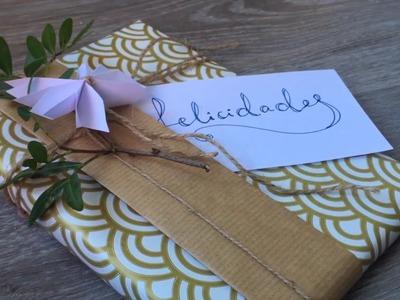 Envolver regalos de forma creativa: lazo de papel y ramillete