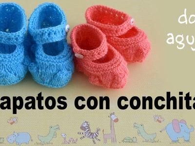 Zapatos con conchitas y correa tejidos a dos agujas para bebés. Tejiendo Perú