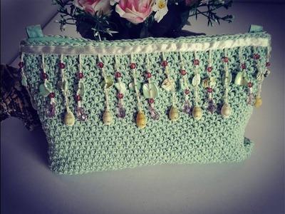 Como tejer bolso de mano. Clutch a crochet con adorno de conchas