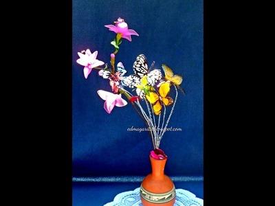 Arreglo con Mariposas Recicladas y Flor de Nailon