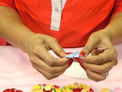 Manualidad 3 - Cojín adornado con flores tipo yoyo