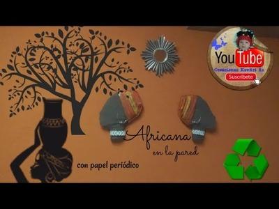 Africana en la pared hecha con papel periódico.DIY Reciclaje.African with news paper