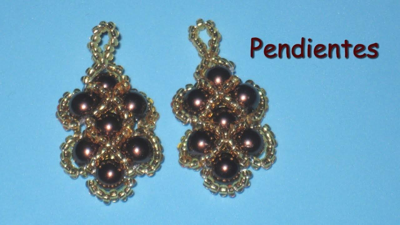 DIY - Pendientes perlas moradas mostacillas doradasDIY - Purple pearl earrings with gold beads