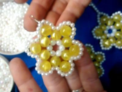 Como hacer flor con perlas