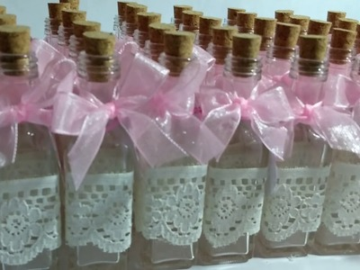 Botellas decoradas para recuerdo de bautizo