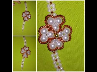 Como fazer pulseira de pérolas flor de pérolas