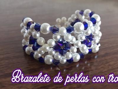 Brazalete de perlas con trompos
