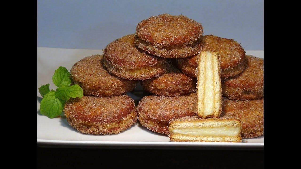 Receta Galletas fritas rellenas de crema pastelera a la vainilla - Recetas de cocina