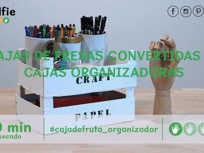 Cajas de fresas convertidas en cajas organizadoras