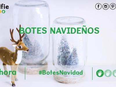 Botes de cristal con paisajes de Navidad