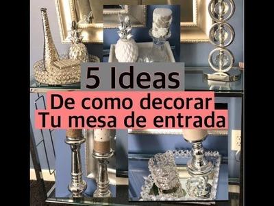 Ideas de como decorar la mesa de la entrada de tu casa.