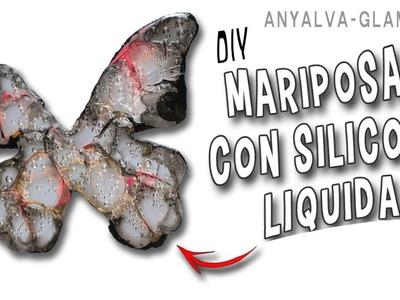 Mariposas con silicona fría y esmaltes de uñas, efecto lupa.