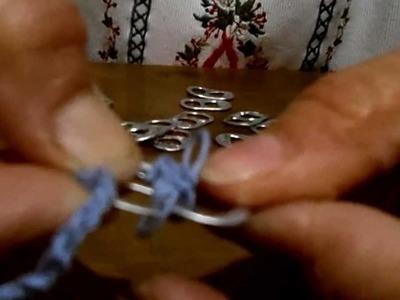 Cinturón con anillas de lata.