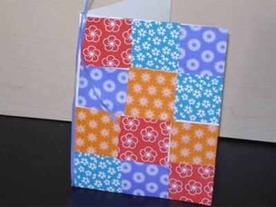 Manualidades de papel: tarjeta.colcha  con pedazos de papeles sobrantes