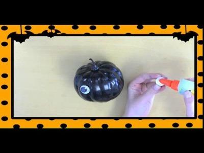 Como hacer una calabaza en forma de araña