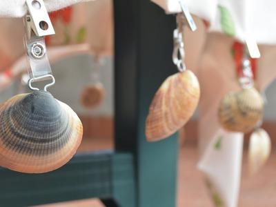 Sujeta manteles para jardín realizado con conchas marinas